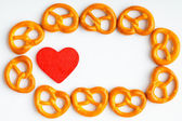 frame of pretzels and red heart white background — Stock Photo