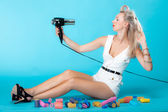Sexy girl retro style in curlers with hairdryer styling hair — Zdjęcie stockowe