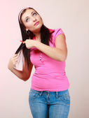 Childish woman infantile girl combing hair. Longing for childhood. — Stock Photo