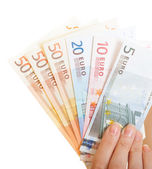 Close-up hand holds euro currency money banknotes. Finance economy — Stock Photo
