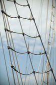 Yacht mast against blue sky — Stock Photo