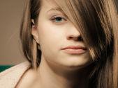 Girl with fringe covered eye — Stock Photo