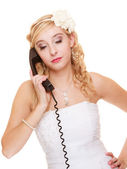 Woman unhappy bride talking on phone — Stock Photo