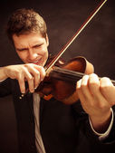 Violinist playing violin — Stock Photo
