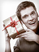 Man got golden gift box — Stock Photo