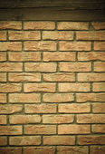 Brick wall with wooden beam background — Photo