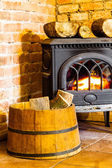 Fireplace with firewood — Stock Photo