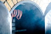 Sausages in smokehouse — Zdjęcie stockowe