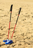 Sticks and shoes on beach — Stock Photo