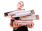 Busy businesswoman carrying stack of folders — Stockfoto