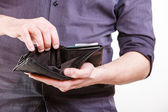 Empty wallet in male hands — Foto de Stock