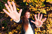 Young woman in autumnal park — Stock Photo