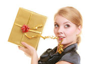Blonde girl with golden gift box — Stock Photo