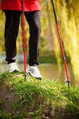 Female legs hiking in the park — Stock Photo