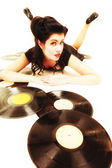 Girl with vinyl records — Stock Photo