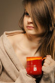 Girl holding cup of hot drink — Stock Photo