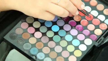 Woman using palette with eye shadow — Stock Video