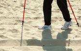 Female legs hiking on the beach — Stock Photo