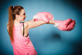 Female boxer wearing gloves — Stock Photo