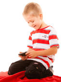 Little boy playing games on smartphone — Stock Photo