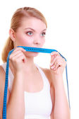 Woman covering her mouth with measuring tape — Stock Photo