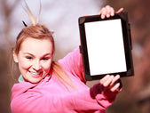 Girl showing tablet outdoor — Stock Photo