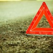 Breakdown of car. Red warning triangle sign on road — Stock Photo #51396421