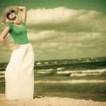 Beautiful blonde girl in hat on beach, summertime — Stock Photo #51396481