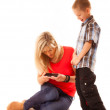 Mother and son playing video game on smartphone — Stock Photo #51396553