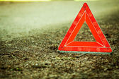 Breakdown of car. Red warning triangle sign on road — 图库照片