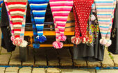 Winter fashion caps on bazaar outdoor — Stock Photo