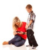Mother and son playing video game on smartphone — Stock Photo