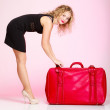 Full length elegant lady in voyage, traveler woman with old red bag — Stock Photo #51432841