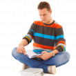 Man college student sitting and reading book studying for exam — Stock Photo