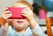 Happy childhood. Blond boy kid child playing with mobile phone — Stockfoto