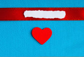 Valentines day background. paper blank heart on blue fabric material — Stockfoto