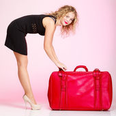 Full length elegant lady in voyage, traveler woman with old red bag — Stock Photo