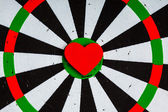 Closeup black white target with heart bullseye as love background — Stock Photo