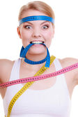 Obsessed sporty fit woman with measure tapes. Time for diet slimming. — Stock Photo
