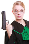 Woman lawyer attorney in polish black green gown with gun — Stock Photo