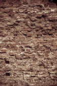 Old grungy background of a brick wall texture — Stock Photo