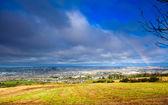 View of town Cork. County Cork, Ireland. Rainbow under city — Stock Photo