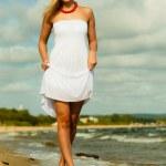 Beautiful blonde girl on beach, summertime — Stock Photo #51546975