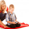 Mother and son playing video game on smartphone — Stock Photo #51547031