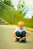 Skater boy child with his skateboard. Outdoor activity. — Stock Photo