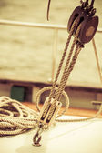 Yachting. Block with rope. Detail of a sailing boat — Stock Photo