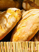 Many brown rustic fresh rye bread loaves — Stock Photo