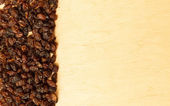Border frame of raisin on wooden table background — Stock fotografie