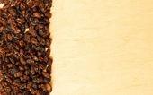 Border frame of raisin on wooden table background — Stock Photo