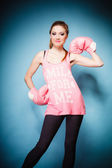 Female boxer wearing big fun pink gloves playing sports — Foto de Stock